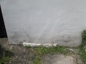 Damp cause by render meeting the ground